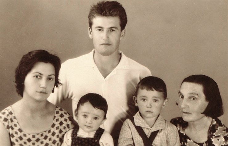 Six-month-old Andrei with his parents, brother and grandmother