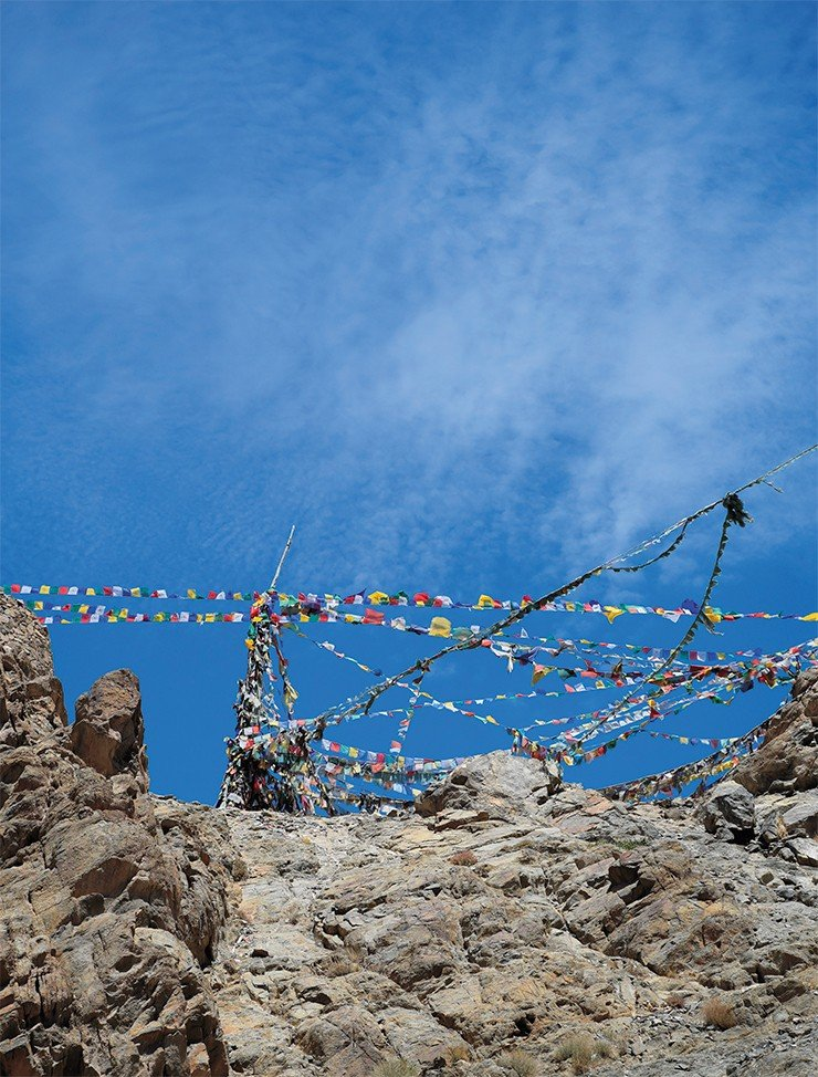 Flags with prayers in the sky of Zanskar