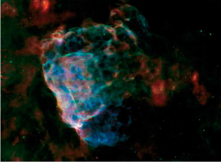 This image shows the destructive force of a powerful supernova explosion. The bubbling cloud is an irregularly shaped shock wave generated by a supernova whose explosion could have been observed from the Earth 3700 years ago. The remnants of this star (the object Puppis A) are about 7000 light years away from us and almost 10 light years in size. The photo is assembled from images in the infrared (red and blue represent wavelengths of 70 µm and 24 µm, respectively) and X-ray (blue) ranges. Credit: NASA/ESA/JPL-Caltech/GSFC/IAFE