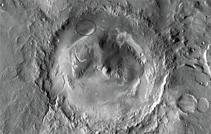 The ancient Martian crater Gale, 154 km in diameter, near the equator in the eastern hemisphere of Mars. Image from Mars Odyssey Orbiter, 2001. Credit: NASA/JPL-Caltech/Arizona State University