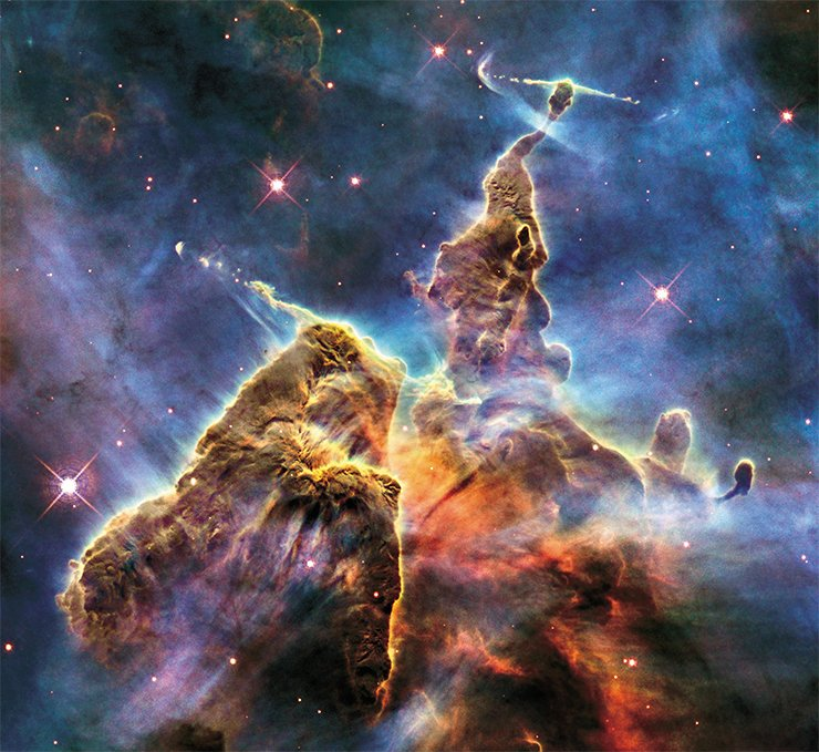 Stars and planets arose from gas-and-dust clouds similar to the cloud with nascent starts in the Carina nebula. NASA, ESA, and M. Livio and the Hubble 20th Anniversary Team (STScI)
