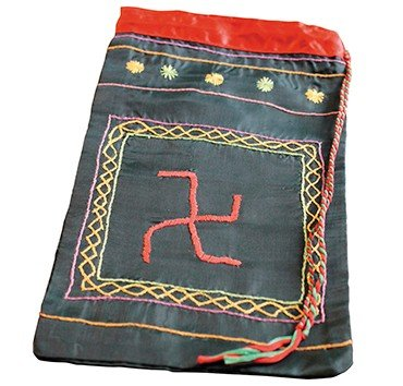 A pouch with a left-hand swastika, the symbol of the Bon Doctrine (as opposed to the right-hand Buddhist swastika). Modern item created by E. Yamaeva, Gorny Altai