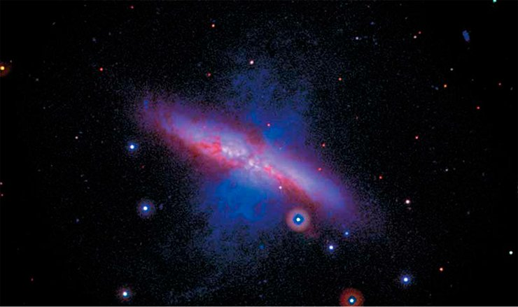 Galaxy M82 before the burst of supernova 2014J. The picture is a collage of data obtained in 2007—2013. The image at ultraviolet wavelengths is shown in blue and green for medium subrange and near subrange, respectively; the red color represents visible wavelengths. The size of the object is a little larger than half the diameter of the full Moon. Credit: NASA/Swift/P. Brown, TAMU