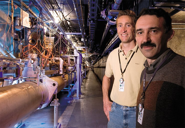 Andrei Seryi with a colleague in the accelerator tunnel at SLAC