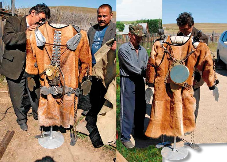 The ritual clothes, made of roe-deer skin, have a metallic model of a human skeleton and protective mirrors  fastened to them.  The mirrors protect the shaman against evil spirits. The final adjustment of the shaman's ritual clothes. The big mirror protects the heart and sternum. On the shoulders, there are figurines of eagles, which are considered to be messengers of gods