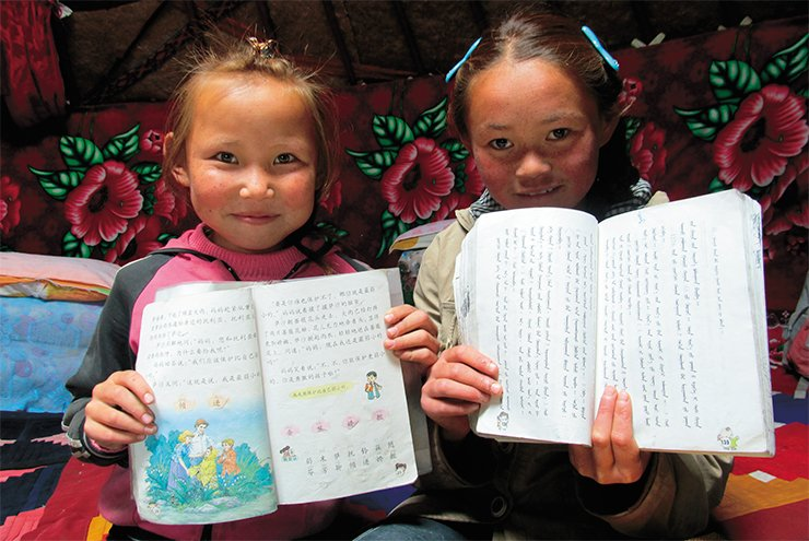 Pupils of the 4th and 5th grades with the textbooks of the Chinese and Mongolian languages