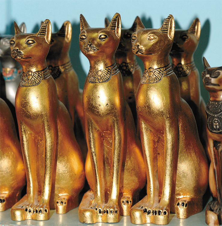 Bronze statues of cats in a modern Egyptian souvenir store. © E. Kozhevnikov – stock.adobe.com