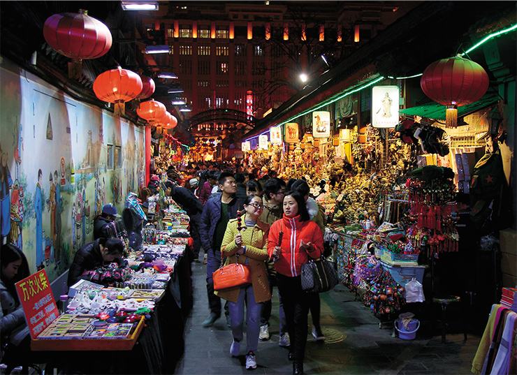 Evening market in Wangfujing, one of the most famous shopping streets in Beijing, where you can buy food and souvenirs or have a snack