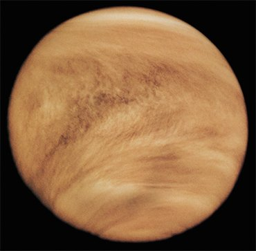 Clouds in the atmosphere of Venus are composed of tiny droplets of highly concentrated sulfuric acid. The V-shape of the clouds is due to the strong winds blowing near the equator. Because of the dense cloud layer, the Venusian surface can be observed only in radio and microwave bands and in some regions of the near infrared. This image of the Venusian surface was made by Pioneer Venus 1 in the ultraviolet rays in 1979. Credit: NASA