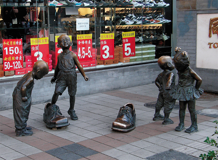 Wangfujing, quite like the Arbat in Moscow, has many narrative sculptures depicting moments from the block's past. This lively scene doubles as a great advertisement of a shoe store nearby