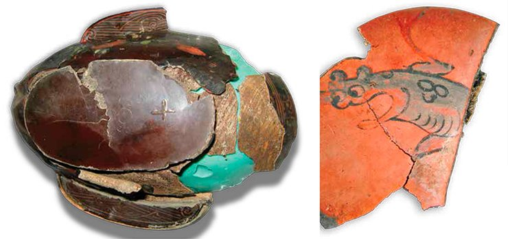 A lacquer cup in the process of restoration. The destroyed artifact displays its wooden base. Tumulus 31, Noin-Ula. Fragment of lacquerware shows a detail of painting – the depiction of a mythical animal. Tumulus 20, Noin-Ula