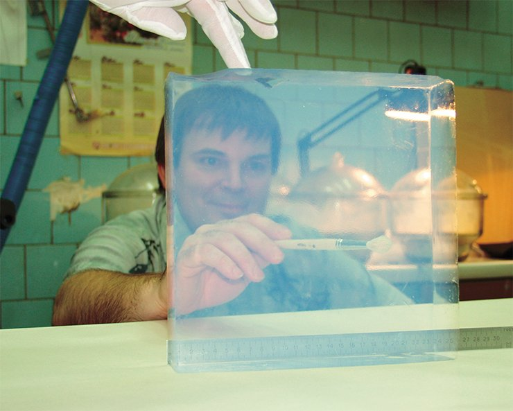 Senior researcher, Candidate of Physicomathematical Sciences E. A. Kravchenko is carefully cleaning the surface of an aerogel block before optical measurements
