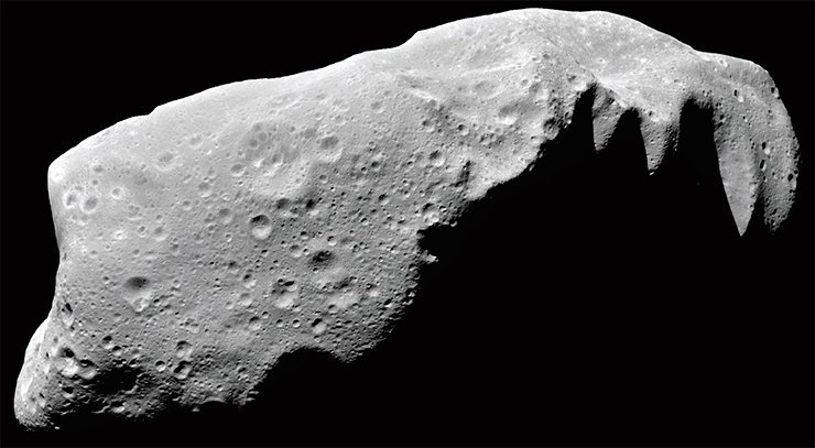 Similar to all other asteroids, this asteroid, 243 Ida, 58 km in length, maintains on its surface the traces of all the processes that took place in the solar system, first and foremost, impact events. Image from NASA's Galileo spacecraft, 1993. Credit: NASA/JPL-Caltech